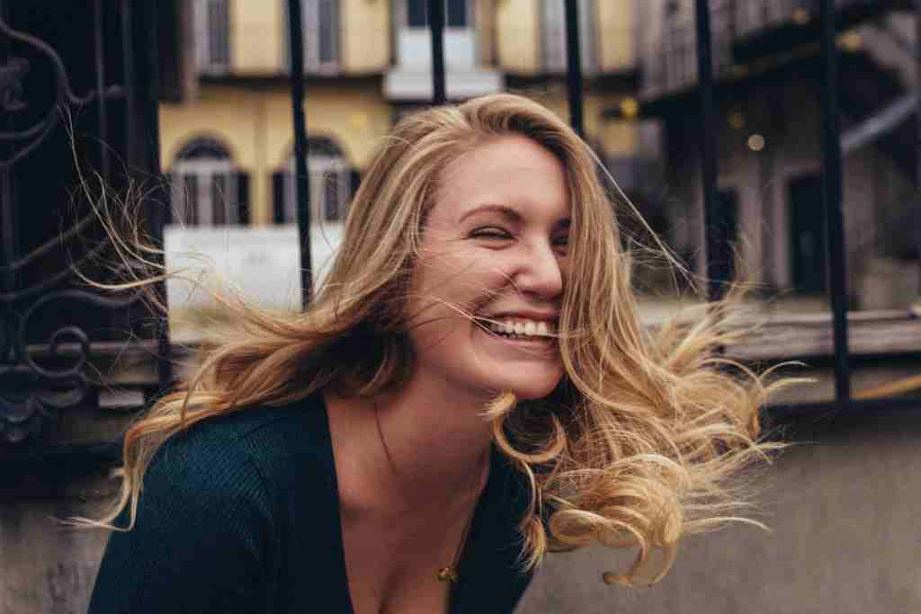 Woman laughing and enjoying life because she feels confident in herself and knows what she needs