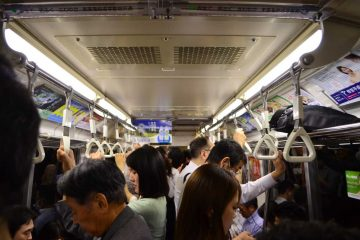 Commuters on a packed tube train feeling like their life has become a never ending routine