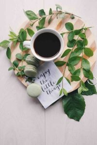 Cup of coffee, some macaroons, and a note saying enjoy the little things - gratitude